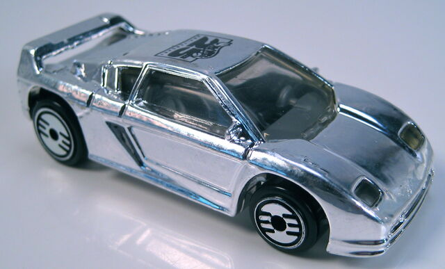 File:Zender fact 4 chrome UH wheels 20th anniversary car.JPG