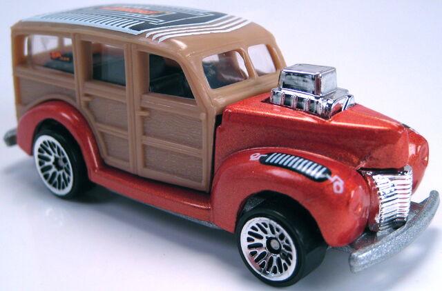 File:40s woodie met orange lace wheels silver painted china base.JPG