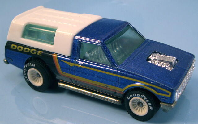 File:Dodge d-50 blue metallic hi raker white hub real riders.JPG