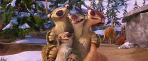 Sid hugging his family