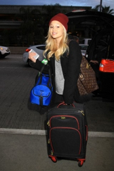 Olivia Holding a Suitcase