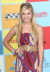 Olivia Wearing Patterned Dress
