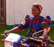 Nun on a mototrbike in Basankusu
