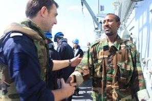 File:A Puntland Coast Guard official meets President Pieter Richard Smith.jpg