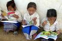 Lao schoolgirls reading books