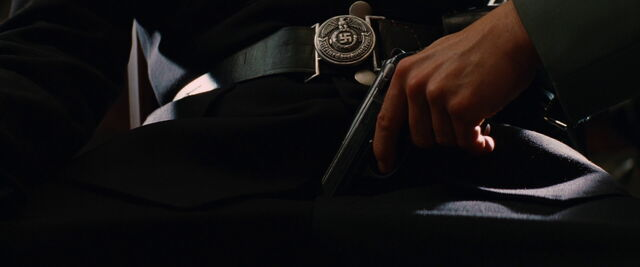 File:Stiglitz with his Walther PPK on Hellstrom's lap.jpg
