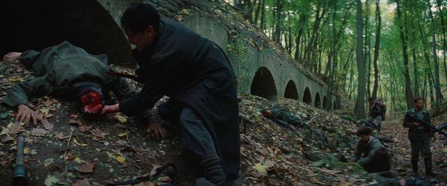 File:Omar scalps Tarantino dummy and a model 24 Stielhandgranate Grenade is in the lower left corner.jpg