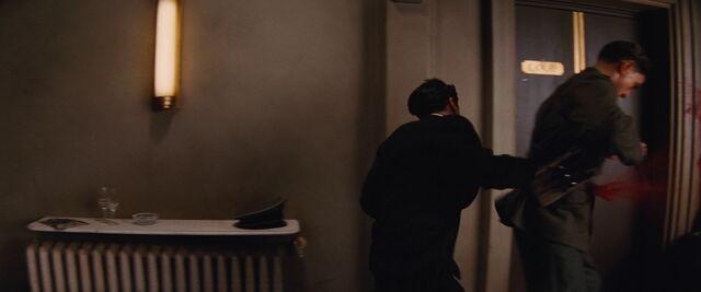 File:Omar shoots guard with OSS Glove Pistol.jpg