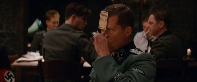 File:Hugo Stiglitz drinks and looks at Hellstrom.jpg