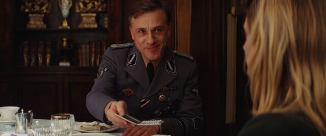 File:Hans Landa offers Shosanna German cigarettes.jpg