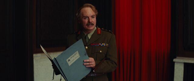 File:Ed Fenech reads Archie Hicox's file.jpg