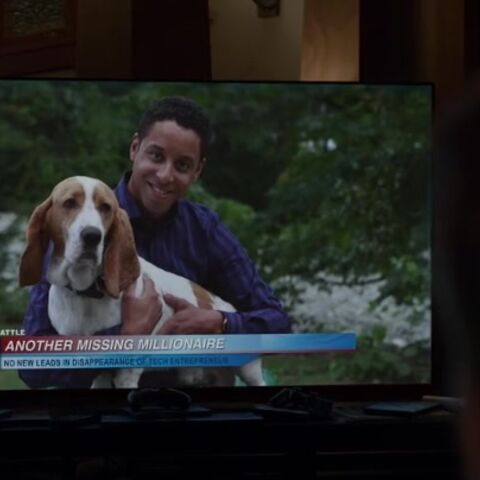 Minor pictured with his original owner during a news broadcast.
