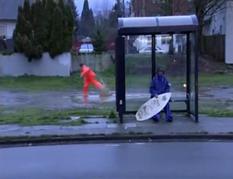 Ehren skimboarding behind Chris,
