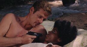Live and Let Die - Rosie is held at gunpoint by Bond