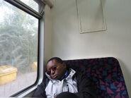 Man sleeping on bus train