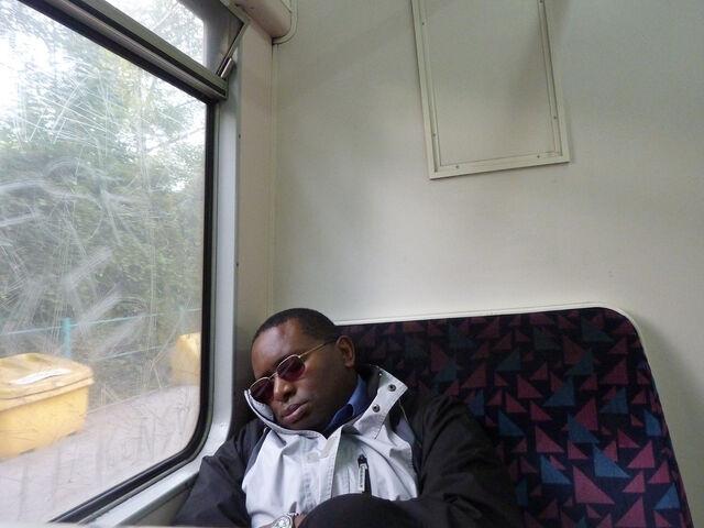File:Man sleeping on bus train.jpg
