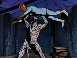 Anubis holds Kareem over his head