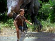 Cooper with a holstered pistol on his right thigh before the Spinosaurus grabs him.