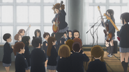 Yui jumps off the stage