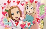 Ritsu and Mugi in the arcade