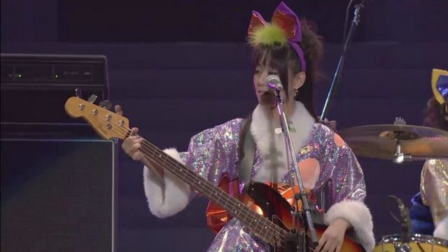 File:Yoko playing bass (Live Concert Let's Go!).jpg