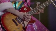 Aki playing guitar (Live Concert Let's Go!)
