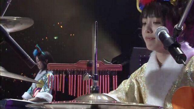 File:Satomi playing drums (Live Concert Let's Go!).jpg