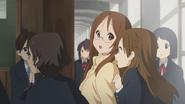 Eri and Ushio drag Sawako inside