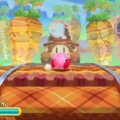 Kirby frente a un tren Waddle Dee