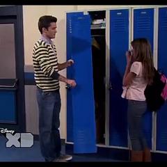 Adam breaks a locker door