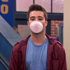 Adam blowing a bubble