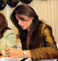 Laura chinchilla firmando-1