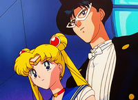 Sailor moon and tuxedo mask attentive