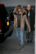 Ne-Yo-wearing-hooded-fur-jacket-and-Louis-Vuitton-Tibet-nubuck-calf-leather-ankle-boots-2
