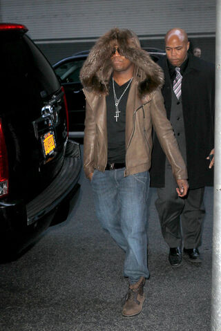 File:Ne-Yo-wearing-hooded-fur-jacket-and-Louis-Vuitton-Tibet-nubuck-calf-leather-ankle-boots-2.jpg