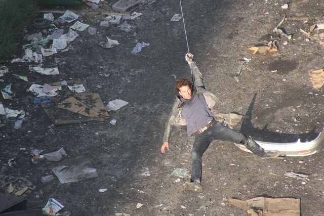 File:Transformers-dotm-tf3-shia-labeoufs-stunt-double-swings-on-cable 4906793518 o.jpg