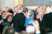 Reagan kisses Nancy after swearing in 1985