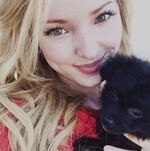 Dove Cameron with puppy