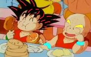 Kid krillin and kid goku eating