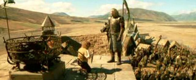 File:Merry kneeling down before King Theoden of Rohan.JPG