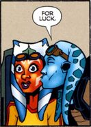 Kidd kisses Ahsoka on the cheek for luck