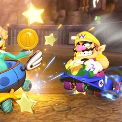 Wario pushes Rosalina, while approaching the track's finish line.