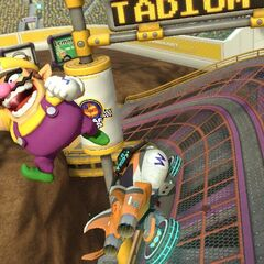 Wario performs a trick at the end of the anti-gravity portion of the track.