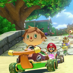 A male villager, along with several other racers, racing on the track.
