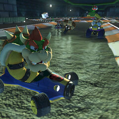 Bowser, and several other characters, racing on the track.