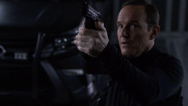 File:Phil-Coulson-Bus-Aims-Gun-Skye.jpg