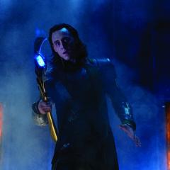 Loki turns to Nick Fury who has seen him enter using the Tesseract.