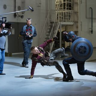 Georges St. Pierre and Chris Evans filming a scene.