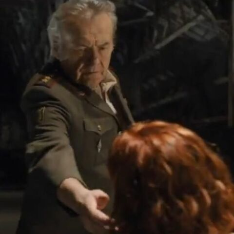 Luchkov gives the phone to Agent Romanoff