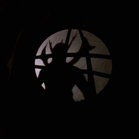 Asmodeus' silhouette through the <a href=